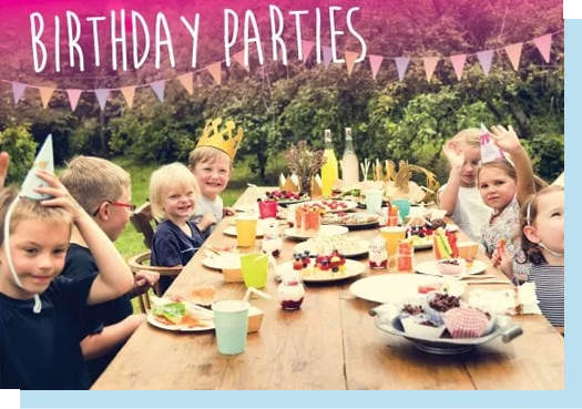 Birthday party including children sat at a wooden table, birthday parties