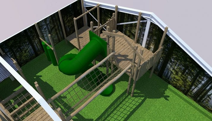 View of the Play Barn layout including green slide and wooden play areas