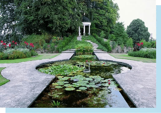 View across the Red Garden and pond towards the domed temple