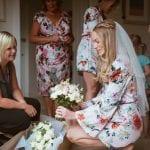 Florist delivering wedding flowers to a bride