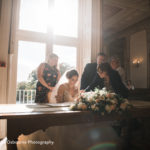Bride signing the register in the Pengelly Room