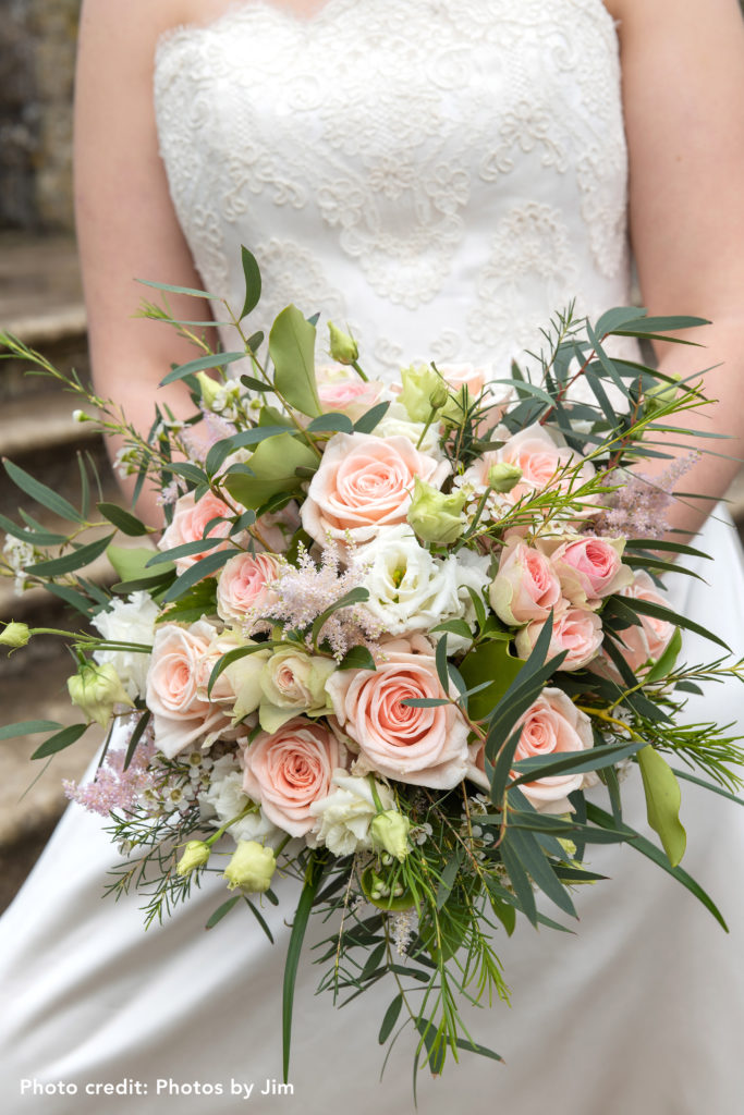Wedding bouquet including light pink roses