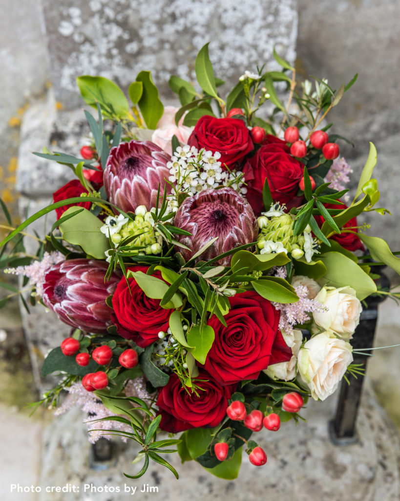 Autumnal Wedding Bouquet including red roses.